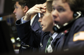 File photo: Traders work on the floor of the New York Stock Exchange before the closing bell February 22, 2011 in New York City.