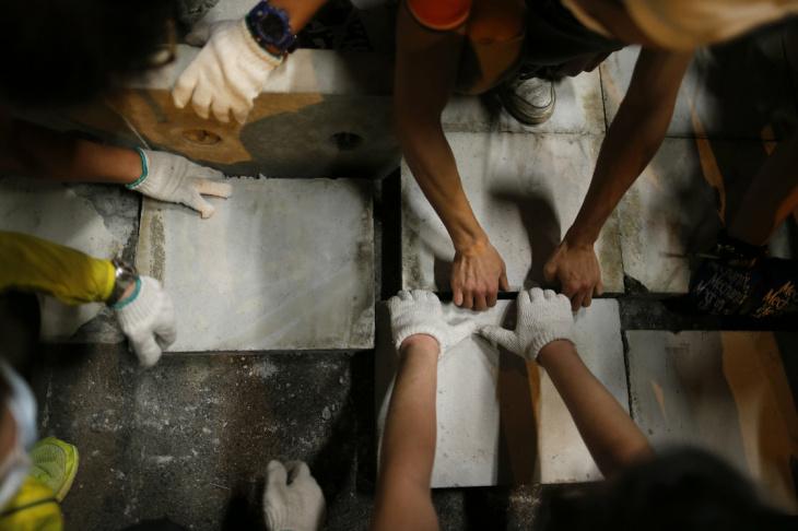 Pro-democracy protesters lay bricks in Hong Kong