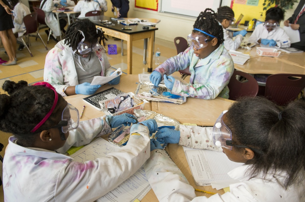 Fifth grade students dissect owl pellets in a science classroom at the Excel Academy Public Charter School in Washington, DC, April 5, 2017,