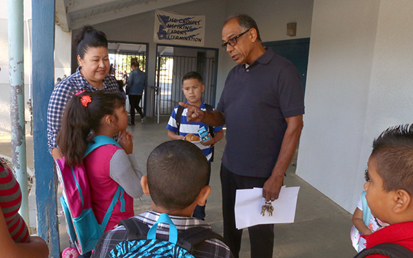 Westside Elementary schools Superintendent/Principal Baldomero Hernandez talks with students on the first day of school, Aug. 13, 2015