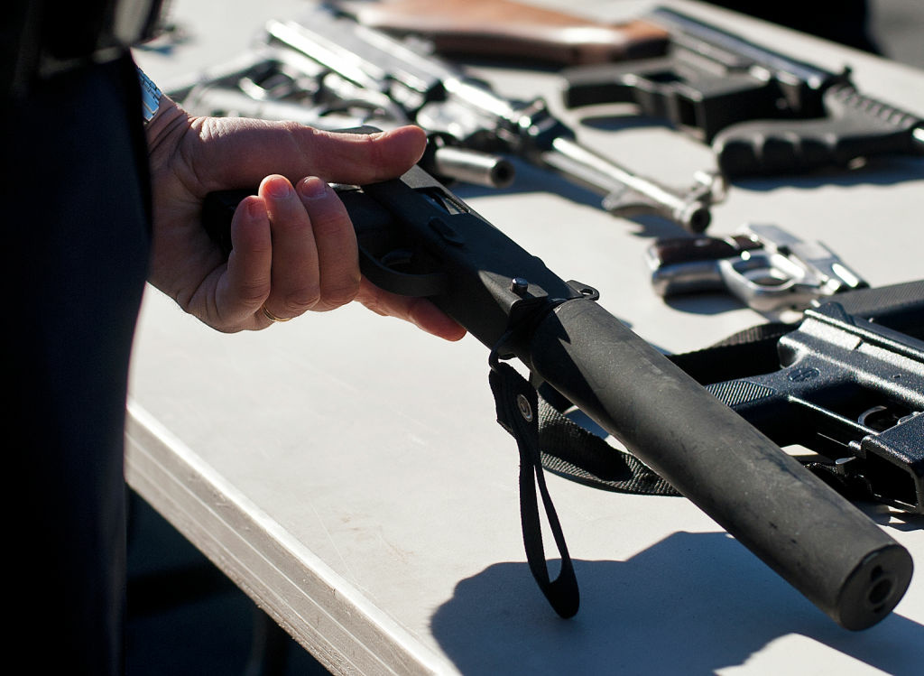 A MAC-12, a blowback-operated machine pistol, with a silencer is turned in at the gun buyback event on Wednesday.