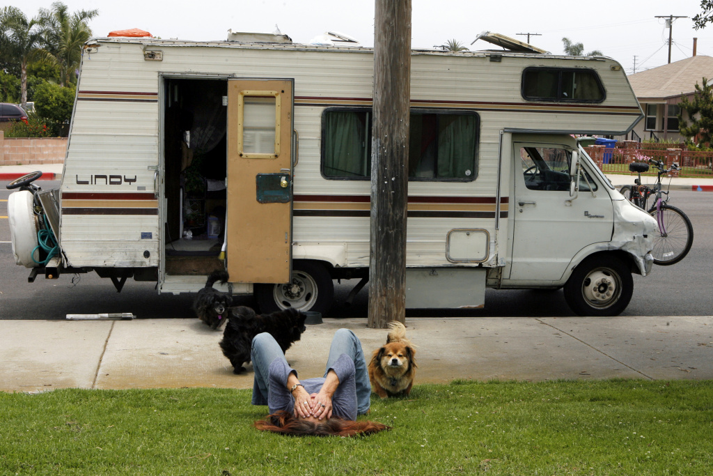 In this file photo, Darlene Knoll, 53, takes a moment to herself, Wednesday, June 4, 2008, in the Los Angeles neighborhood where she resides with five dogs in her battered 1978 motor home after losing her job and home five years earlier. Under an Assembly bill meant to protect homeless people, local governments could not punish people caught sleeping in cars. AB718 advanced to the Senate on Monday, June 1, 2015, with a 54-to-12 vote.