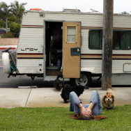 In this file photo, Darlene Knoll, 53, takes a moment to herself, Wednesday, June 4, 2008, in the Los Angeles neighborhood where she resides with five dogs in her battered 1978 motor home after losing her job and home five years earlier.
