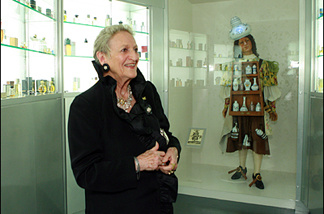 Annette Green in her perfume museum at FIDM in LA. The dummy in the case is an old French perfume salesman. Nice hat.