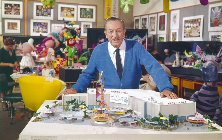 This 1964 photo released by Disney shows Walt Disney with a model of the
