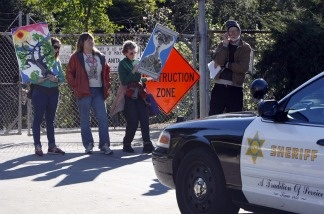 Protesters, left to right, Jennifer MacDonald, Kim Kelley, Laurie Gould and David Czamanske demonstrate on Jan. 12, 2011 in Arcadia to save 11 acres of old oaks and sycamore trees that Los Angeles County officials say must be cleared away so that sediment dredged from behind a dam can be dumped there.