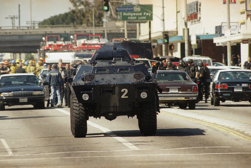 A Los Angeles Police Department armored personnel carrier maneuvers down Victory Boulevard, Friday, Feb. 28, 1997 in the North Hollywood section of Los Angeles. Police broke up a blotched bank robbery with a group of men dressed like commandos. (AP Photo/Michael Tweed)