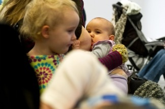 Women breastfeed their babies at the Hirshhorn Museum in Washington  during a 'nurse-in' organized after a woman was stopped from nursing in public at the museum by security guards.