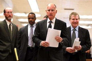 Gov. Jerry Brown walks with advisors to a press conference about his proposed budget at the California State Capitol on Jan. 10, 2011 in Sacramento.