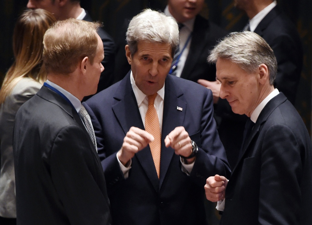 File: Secretary of State John Kerry and British Secretary of State for Foreign and Commonwealth Affairs Philip Anthony Hammond speak during a United Nations Security Council meeting on Syria on Dec. 18, 2015.
