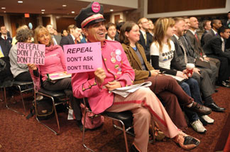 "Activists attend the Senate Armed Services Committee hearing on issues associated with a repeal of section 654 of title 10, United States Code, 'Policy Concerning Homosexuality in the Armed Forces', also known as the ""Don't Ask, Don't Tell"" policy, December 2, 2010 in Washington, DC."