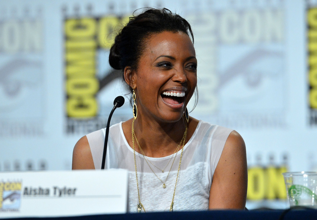 Actress Aisha Tyler speaks onstage at the