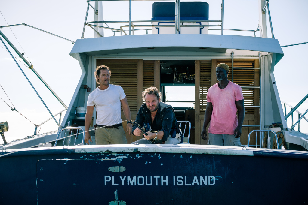 Baker Dill (Matthew McConaughey), Frank (Jason Clarke) & Duke (Djimon Hounsou) fish for big game on a dangerous excursion in SERENITY.