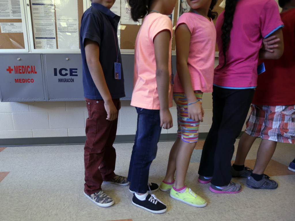 FILE: Detained immigrant children line up in the cafeteria at a temporary home for immigrant women and children detained at the border, in Karnes City, Texas.