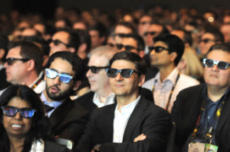 Moviegoers wear 3-D glasses to watch a 3-D film.