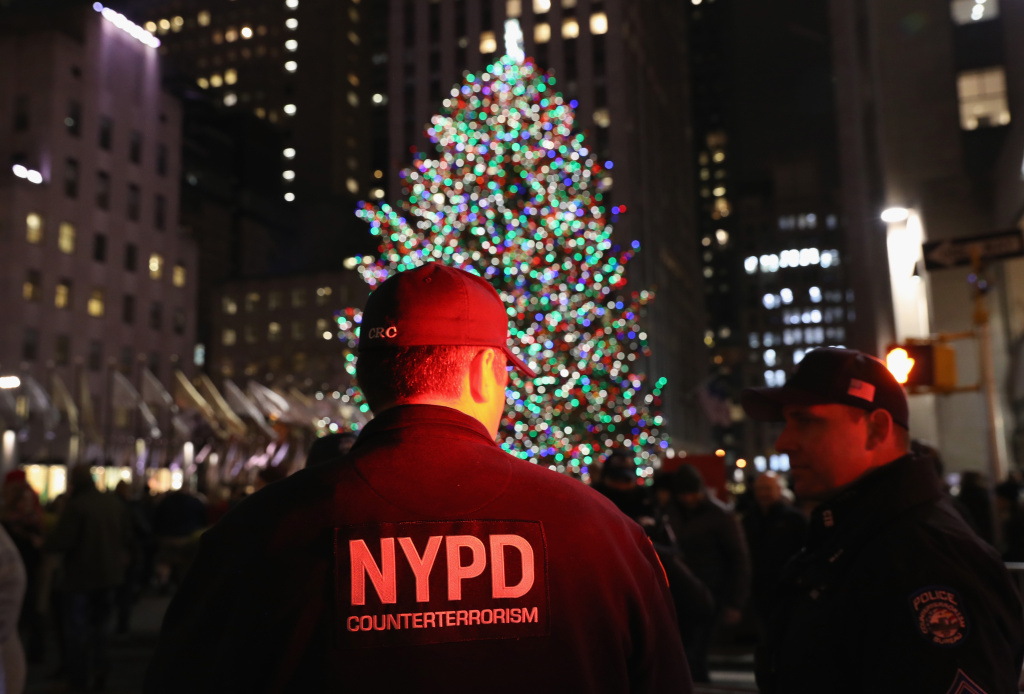 Counterterrorism police stand guard near the Christmas tree at Rockefeller Center on December 12, 2017 in New York City.