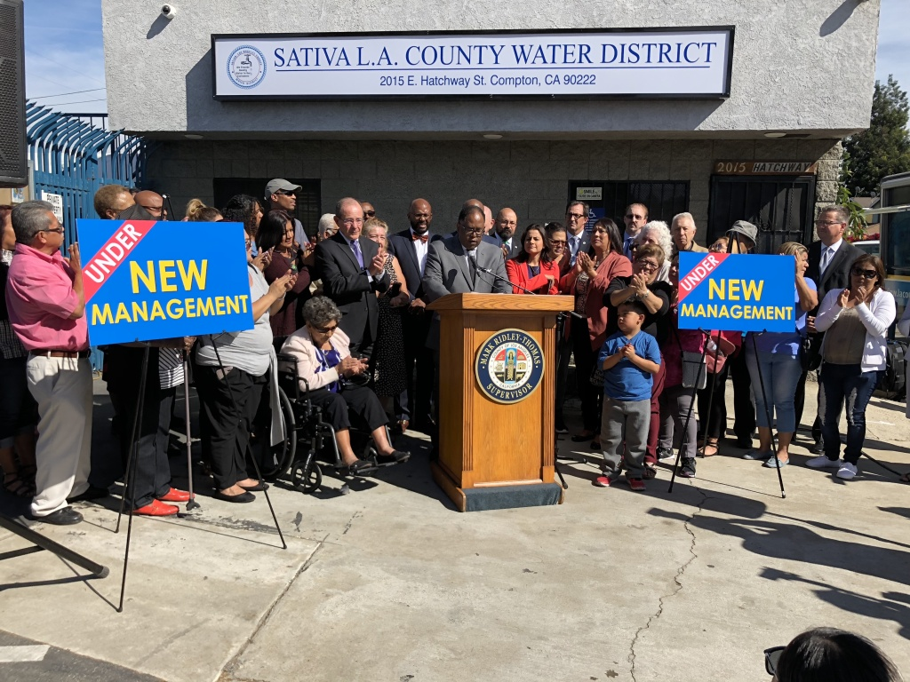 Government officials and local residents flank LA County Supervisor Mark Ridley-Thomas as he announces the county's take over of Sativa Water District.