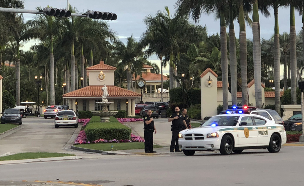 Police respond to The Trump National Doral resort after reports of a shooting inside the resort Friday, May 18, 2018 in Doral, Fla. A man shouting about Donald Trump entered the president's south Florida golf course early Friday, draped a flag over a lobby counter and exchanged fire with police before being arrested, police said. One officer received an unspecified injury, officials said.