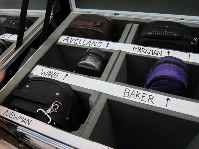 Christopher Still, a trumpeter for the Los Angeles Philharmonic, prepares his wardrobe and instrument for the tour.