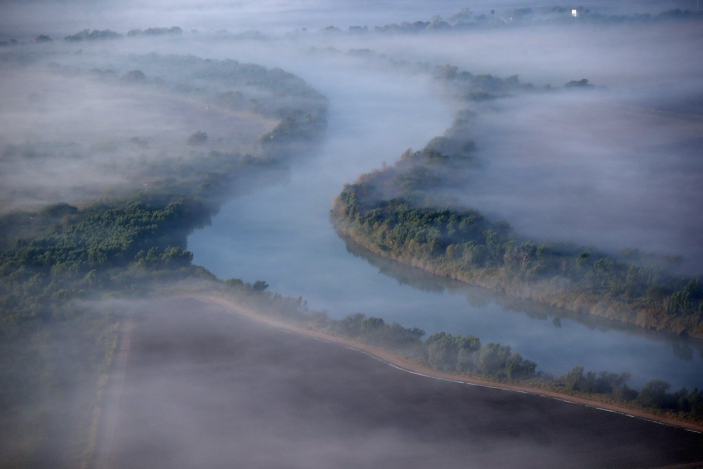 A fog slowly lifts over the Rio Grande, which divides the United States from Mexico.