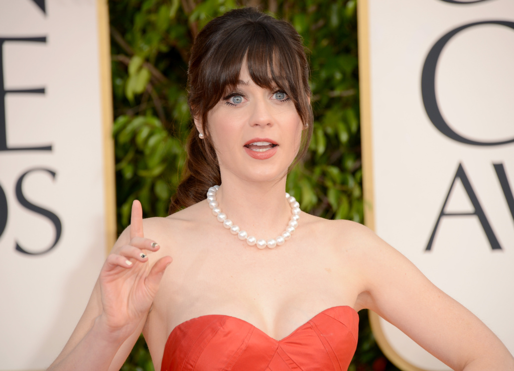 Actress Zooey Deschanel arrives at the 70th Annual Golden Globe Awards held at The Beverly Hilton Hotel on January 13, 2013 in Beverly Hills.