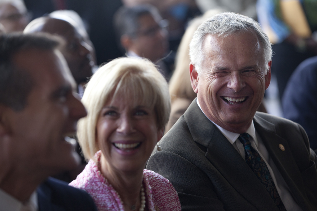 Mayor Eric Garcetti, left, Congresswoman Janice Hahn and her brother, Superior Court Judge James Hahn joke during the ceremony to name the City Hall East building after justice Hahn, who was the L.A. city controller, city attorney and mayor.