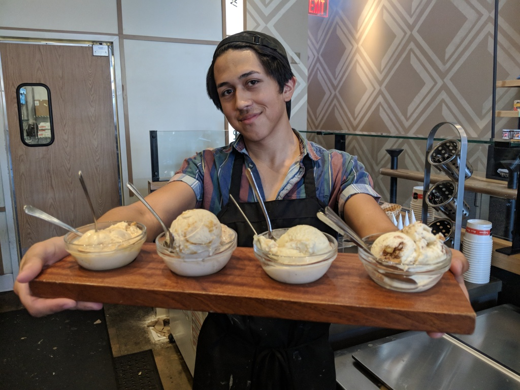 Salt & Straw employee Chuy Hernandez shows off a tasting flight of Thanksgiving ice cream flavors.
