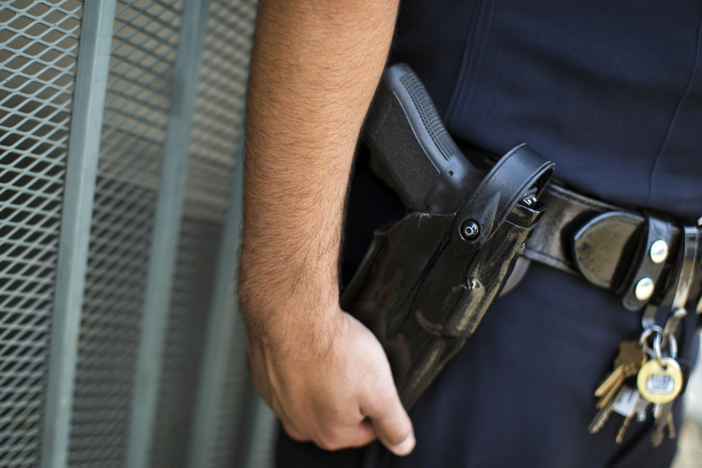 An LAPD police officer in uniform, with gun holstered.