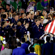 Flag bearer Michael Phelps of the United States and Ibtihaj Muhammad lead the U.S. Olympic Team during the Opening Ceremony of the Rio 2016 Olympic Games at Maracana Stadium on August 5, 2016 in Rio de Janeiro, Brazil.