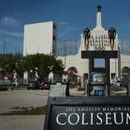 The Los Angeles Memorial Coliseum, venue for two previous Olympic Games, is seen in this on August 26, 2015 in Los Angeles, California. The Coliseum would be renovated and used as the main stadium if the city bids for the 2024 Summer Olympics. The Los Angeles city council is reviewing a $4.1 billion bid proposal for the 2024 Summer Olympics that backers say could produce a surplus of $161 million if the city is awarded a third Summer Games. A 218-page bid book made public on August 25 shows plans for a Los Angeles Games rely on private-sector partners to pay more than $1.7 billion in venue costs and includes revenue projections such as $4.8 billion from ticket sales, broadcast rights and corporate sponsorships