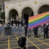 A supporter of same-sex marriage waves a flag outside the Judicial Yuan in Taipei on March 24, 2017. Taiwan's constitutional court began hearing a landmark case on March 24 that could make the island the first place in Asia to allow same-sex marriage. / AFP PHOTO / SAM YEH        (Photo credit should read SAM YEH/AFP/Getty Images)