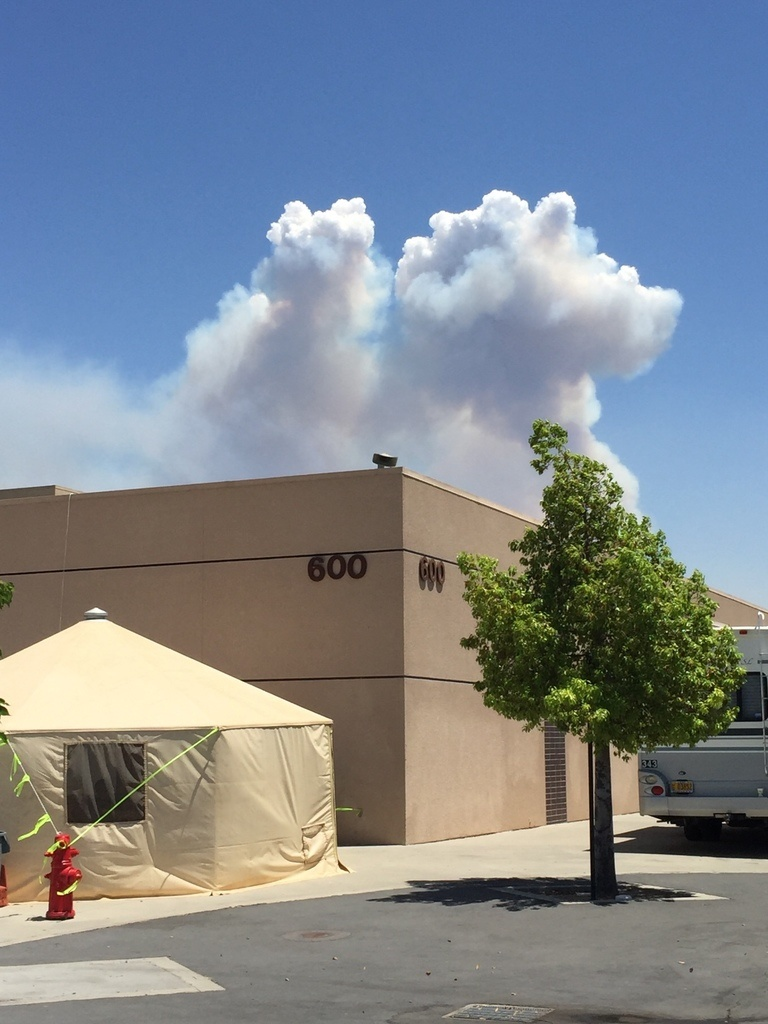 A large cloud plume appears above the Santa Clarita Incident Command Center July 26, 2016.