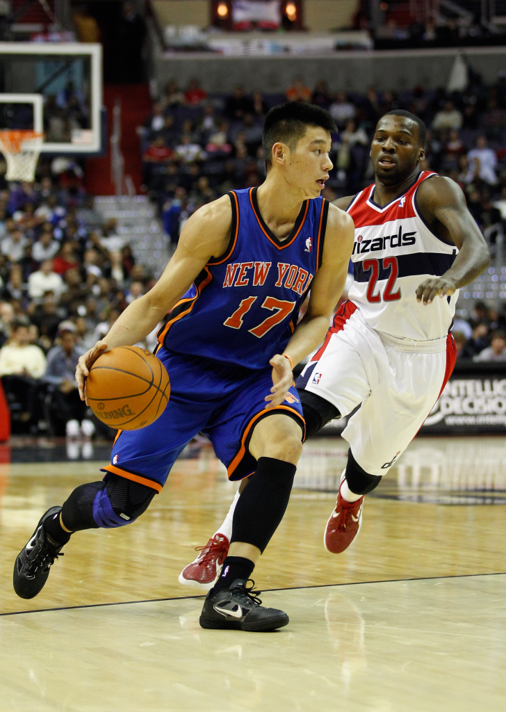 Jeremy Lin #17 of the New York Knicks drives to the basket while being guarded by Shelvin Mack #22 of the Washington Wizards during the first half at Verizon Center on February 8, 2012 in Washington, DC.
