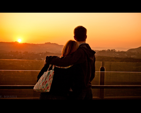A couple watches the sunset at the Griffith Observatory.