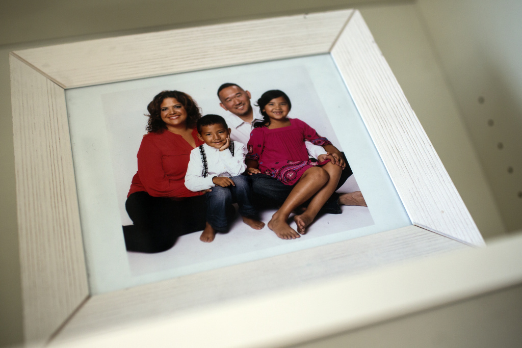 A photograph of Sonia Smith-Kang, her husband and their two youngest children is on display inside her downtown Los Angles workspace.
