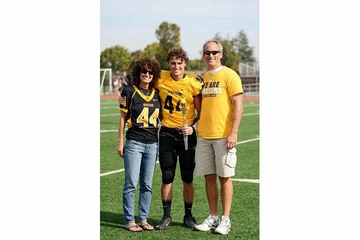 Danny Holton with his mom and dad, Carolyn and John, at a high school football game.