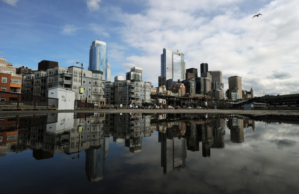 View of the skyline in the city of Seattle, Washington state on March 22, 2011.  Seattle is the northernmost major city in the contiguous United States, and the largest city in the Pacific Northwest. The city is home to corporations such as Boeing, Starbucks and Microsoft.             AFP PHOTO/Mark RALSTON (Photo credit should read MARK RALSTON/AFP/Getty Images)