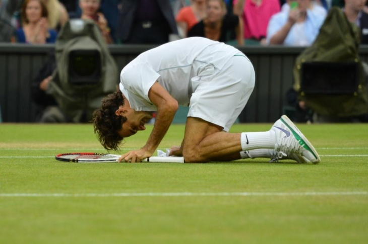 Switzerland's Roger Federer falls to his