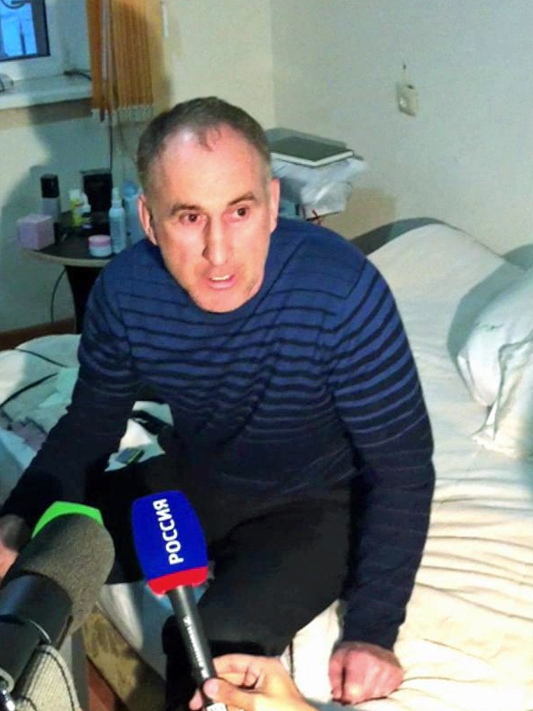 In this image taken from a mobile phone video, the father of Boston bomb suspects, Anzor Tsaraev reacts as he talks to the media about his sons, in his home in the Russian city of Makhachkala on Friday.