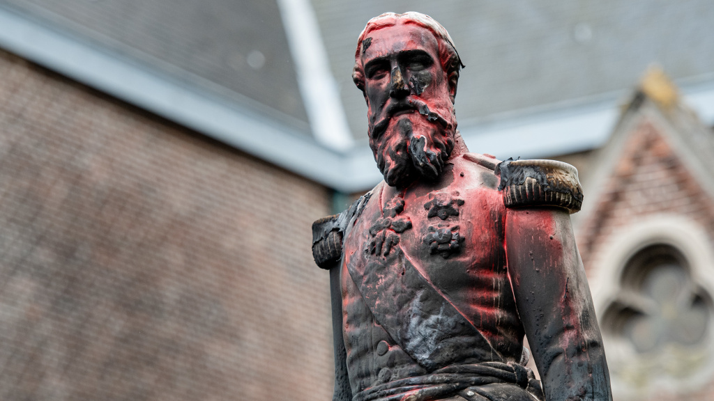 A statue of King Leopold II of Belgium is pictured on June 4 in Antwerp after it was set on fire the night before. Activists want statues of the colonial-era monarch removed.