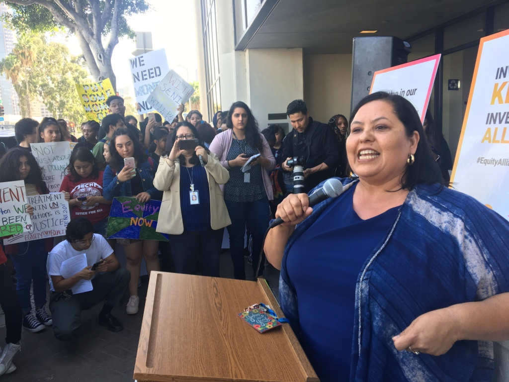 Los Angeles Unified school board president Mónica García addresses a crowd of students and parents from Inner City Struggle and the Community Coalition of South L.A. The group gathered on Tuesday, April 10, 2018, to support García's resolution to re-write the district's