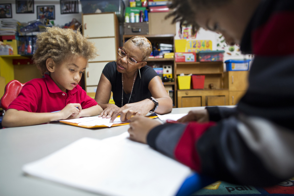 Tonia McMillian helps 7-year-old Jayden with his homework after school on Feb. 12.