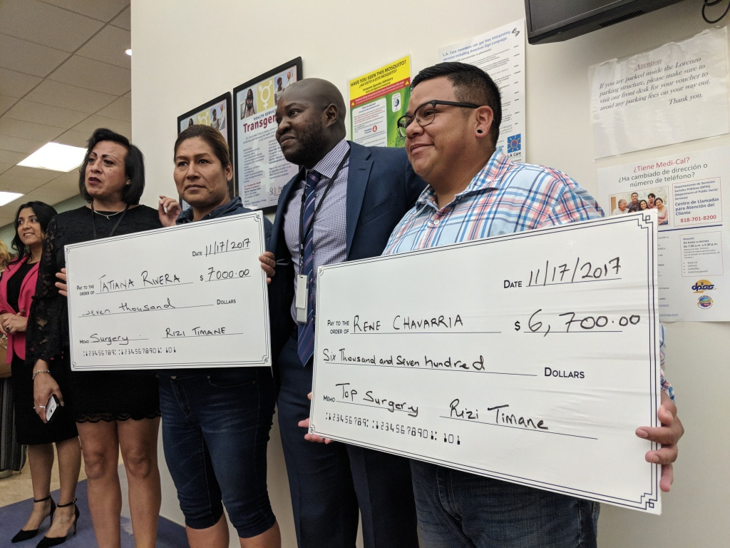 Trans activist Rizi Timane (center) stands with Rene Chavarria (r) and Tatiana Rivera (l), two recipients of his scholarship program that awards money to trans people looking for help paying for surgery.