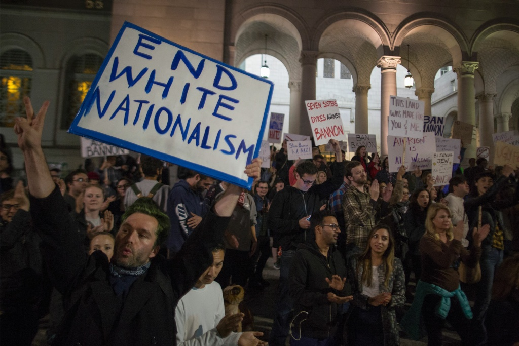 People protest the appointment of white nationalist alt-right media mogul, former Breitbart News head Steve Bannon, to be chief strategist of the White House by President-elect Donald Trump on November 16, near City Hall in Los Angeles, California. / AFP / DAVID MCNEW        (Photo credit should read DAVID MCNEW/AFP/Getty Images)