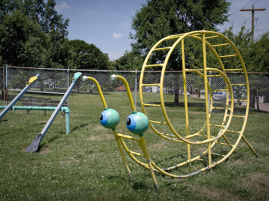 A giant metallic ladder in the shape of a snail. Located in Vandergrift, Pennsylvania, this piece reflected a period in which equipment was designed to be more fun and playful.