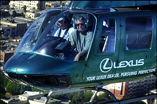 Jeff Baugh, right, at work as traffic reporter, with pilot Gary Lineberry.