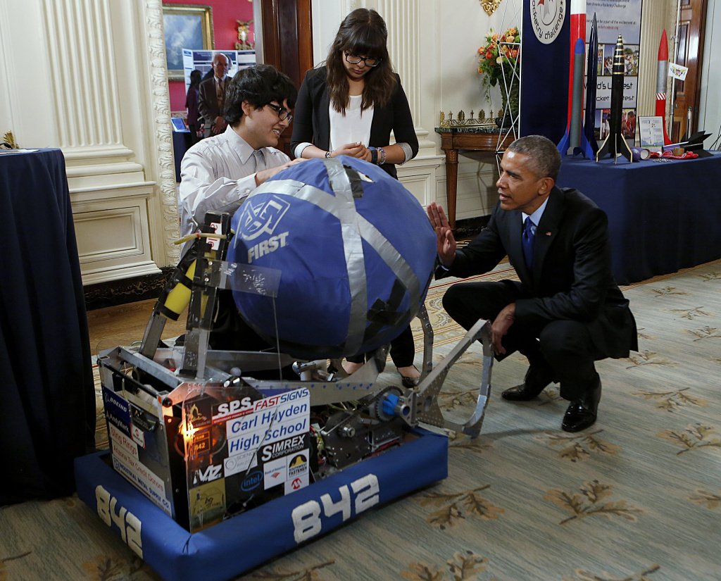 U.S. President Barack Obama looks at the invention of Sergio Corral and Isela Martinez from Phoenix, Arizona, during the 2015 White House Science Fair on March 23, 2015 in Washington, DC.
