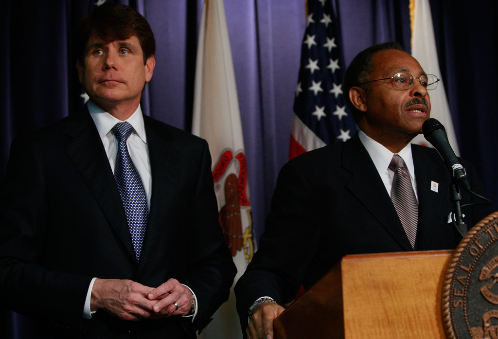 Former Illinois Governor Rod Blagojevich (L) with his choice to fill the U.S. Senate seat vacated by President Barack Obama, former Illinois Attorney General Roland Burris (R) in 2008.