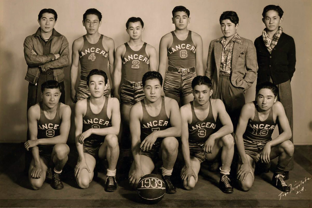 The Lancers, a Los Angeles-based Japanese American league basketball team, pose for a team portrait in 1939.