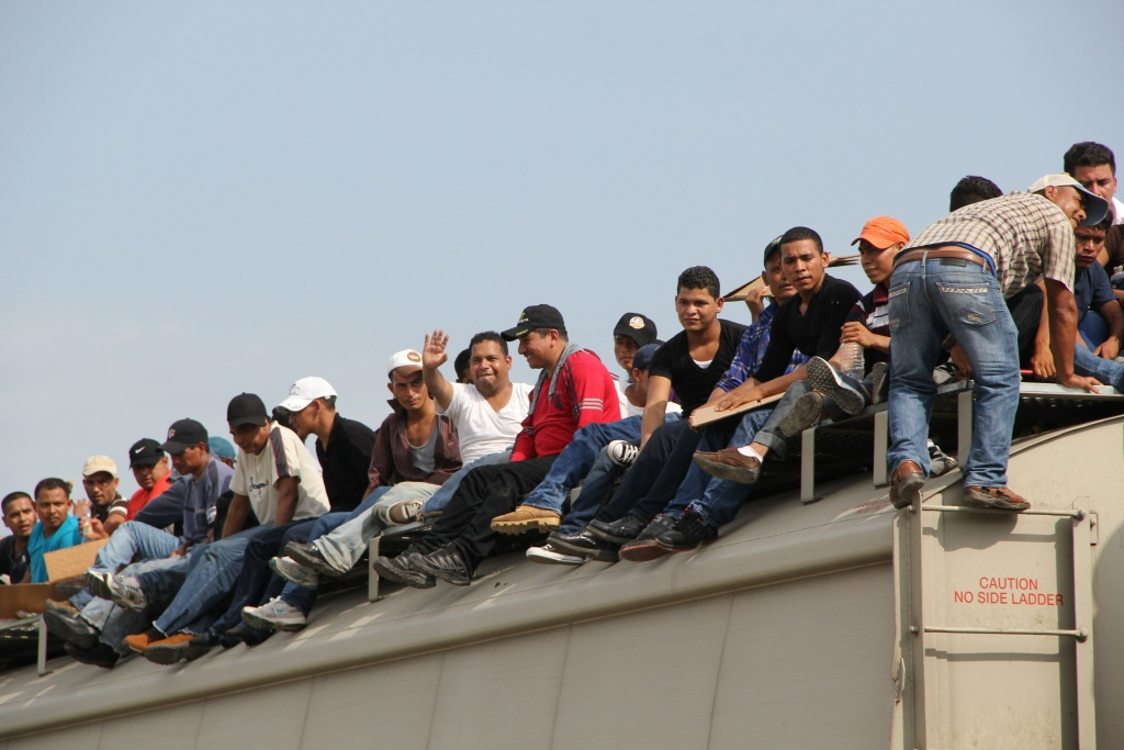 Central American immigrants sit atop the so-called La Bestia (The Beast) cargo train, in an attempt to reach the Mexico-US border on July 16, 2014.